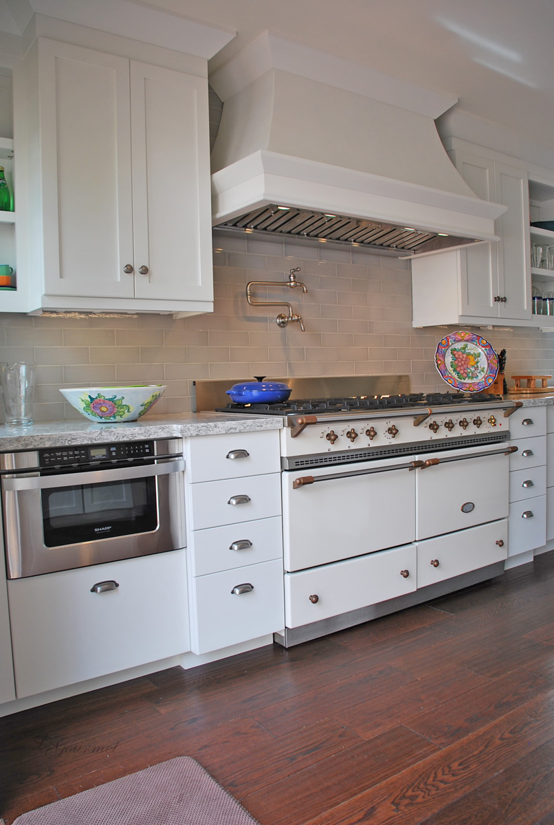 kitchen design with oven and custom hood